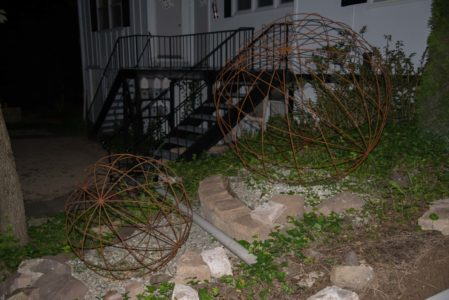 two large wire frame sphere sculptures